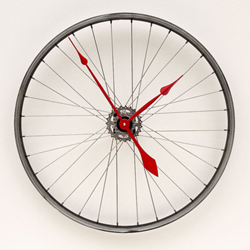 a recycled bicycle wheel clock